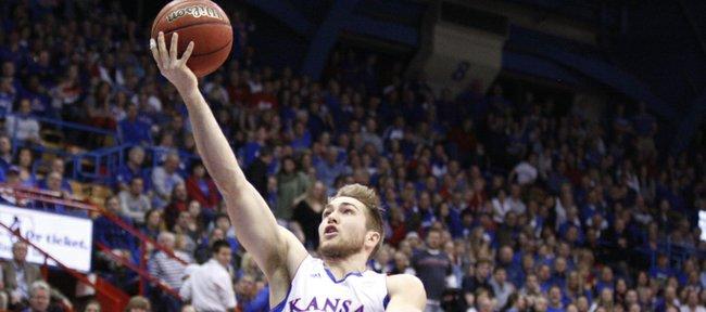 Kansas guard Jordan Juenemann puts in a bucket past Texas Tech defenders Jaye Crockett, left, and Deshon Minnis during the second half on Saturday, Feb. 18, 2012 at Allen Fieldhouse.