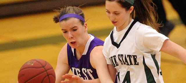 Free State's Hadyn Hutchison (14) tries to steal the ball from Topeka West's Regan Braum in the second half on Friday, Jan. 25, 2013, at FSHS.