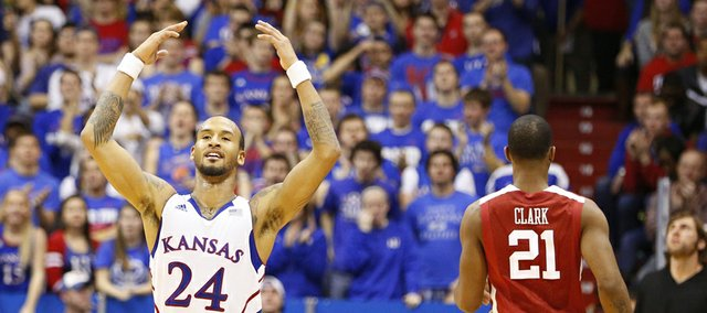 Kansas guard Travis Releford raises up the fieldhouse during a Jayhawk run against Oklahoma in the second half on Saturday, Jan. 26, 2013.
