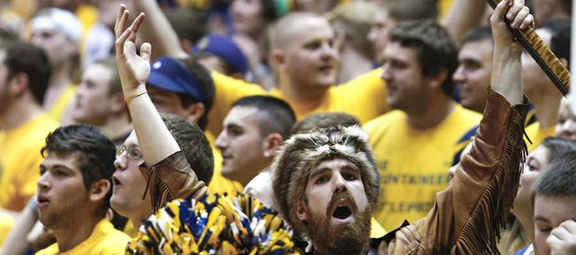 The West Virginia Mountaineer mascot, Jonathan Kimble, cheers during the first half West Virginia's game with Kansas State on Jan. 12, 2013, in Morgantown, W.Va.