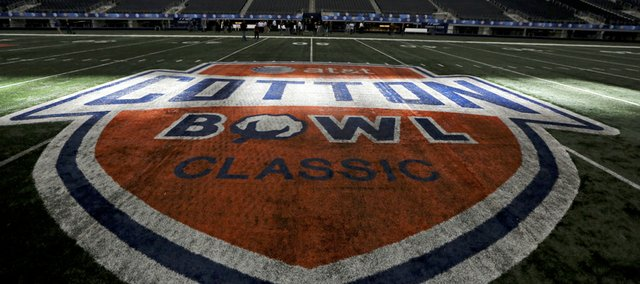 Sun shines on the midfield logo for the Cotton Bowl at Cowboys Stadium on Sunday, Dec. 30, 2012, in Arlington, Texas.