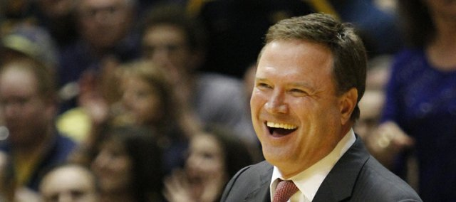 Coach Bill Self laughs at a call in the second-half of the Jayhawks 61-56 win against the Mountaineers Monday night at West Virginia University.
