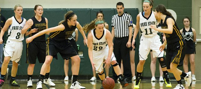 Free State junior Scout Wiebe (22) steals the ball away from Marleah Campbell during Free State's game against Shawnee Mission West, Tuesday, Jan. 29, 2013 at FSHS.
