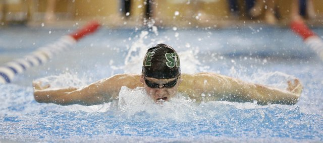 Free State swimmer Ben Sloan cuts through the water as he competes in the 200-yard individual medley event of the Free State Invitational on Thursday, Jan. 10, 2013.