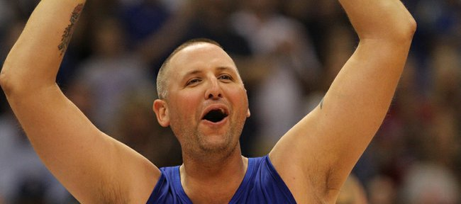 Former Kansas University center Greg Ostertag gets a big ovation as he is introduced before the Legends of the Phog alumni game Saturday, Sept. 24, 2011 at Allen Fieldhouse.