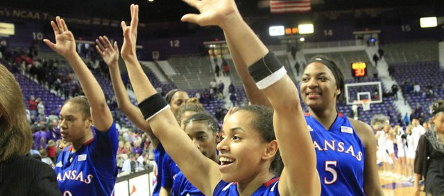 Kansas' Angel Goodrich (3) celebrates with KU fans after the Jayhawks' 89-80, double-overtime victory over Kansas State on Saturday, Feb. 2, 2013, in Manhattan.