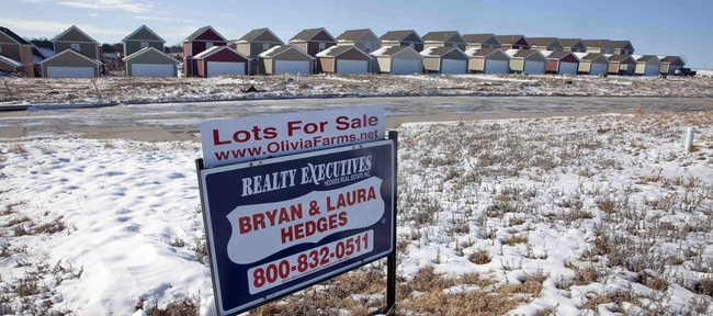 A realty sign sits on property at the Olivia Farms housing development in Junction City. Records provided by the Geary County Treasurer's Office show that a development company of which local developer Thomas Fritzel is an owner has $3.42 million in unpaid property taxes and special assessments stemming from Fritzel's involvement in Fort Development LLC, a company that in 2008 built the now-struggling Olivia Farms housing development in Junction City. Fritzel is seeking to enter into a partnership with the Lawrence and Kansas University to build Rock Chalk Park. BELOW: A sign marking the Olivia Farms development in Junction City.
