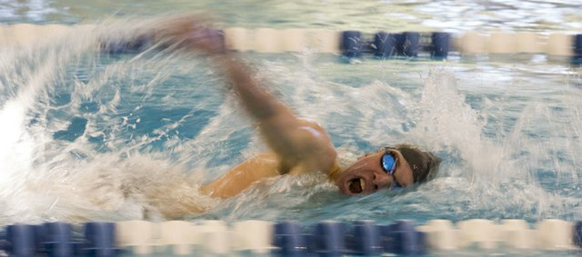 Free State High's Canaan Campbell competes in the 500-yard freestyle during the Sunflower League Swimming and Diving Championship on Saturday, Feb. 2, 2013, at the Lawrence Indoor Aquatic Center. Campbell won the event.