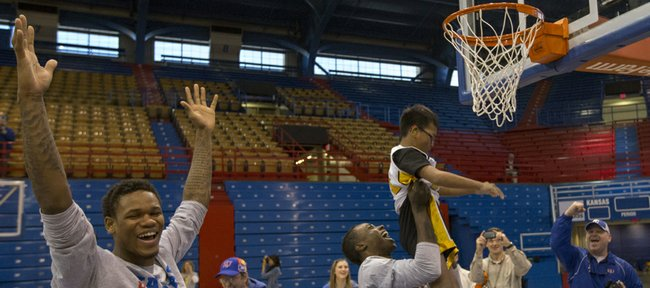 Kansas guard Ben McLemore throws his hands up in celebration after teammate Rio Adams helps camper Austin Bouahome dunk the ball during the Wilt Chamberlain Special Olympics Kansas Basketball Clinic held Sunday, Feb. 3, 2013 at Allen Fieldhouse.