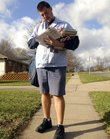 In this file photo by Journal-World staffer Richard Gwin, postal carrier Matt Woodruff delivers mail on his route in Lawrence.