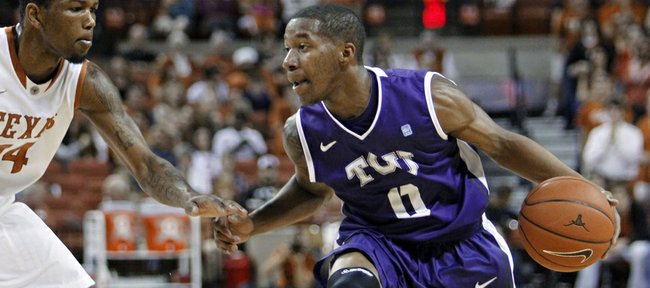 TCU guard Charles HIll, Jr. right, looks to drive around Texas guard Julien Lewis during the first half of an NCAA college basketball game, Saturday, Feb. 2, 2013, in Austin, Texas.