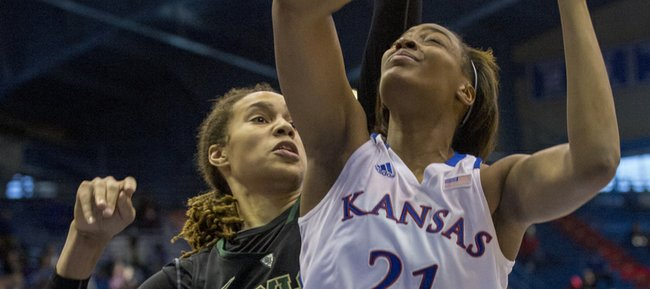 Brittney Griner, left, goes for a block as Kansas forward Carolyn Davis (21) tries to get a shot off during Kansas' game against Baylor, Sunday, Jan. 13, 2013 at Allen Fieldhouse.
