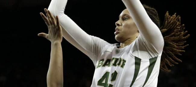 Baylor&#39;s Brittney Griner (42) shoots over Kansas&#39; Bunny Williams during the first half of an NCAA college basketball game on Wednesday, Feb. 6, 2013, in Waco Texas. Baylor won 86-45. 