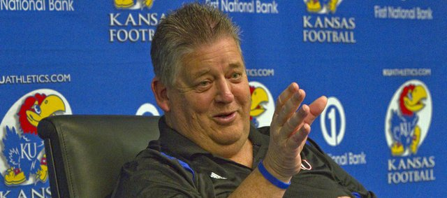 Kansas football coach Charlie Weis meets with media reps on Wednesday, Feb. 6, 2013, to talk about his latest recruiting class.