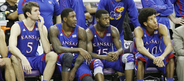 From left Jeff Withey, Jamari Traylor, Elijah Johnson and Kevin Young, watch the final seconds of the Jayhawks 62-55 loss to Texas Christian University, Wednesday at TCU in Fort Worth, Texas.