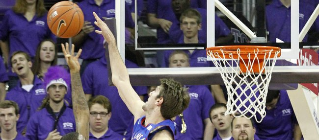 Kansas center Jeff Withey (5) blocks a shot by TCU's Connell Crossland (2) in the Jayhawks' game Wednesday at TCU in Fort Worth, Texas.
