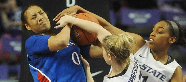 KU's Asia Boyd, left, tries to control a rebound against Kansas State's Kendra Spresser (13) and Haley Texada (1)  on Saturday, Feb. 2, 2013, in Manhattan.