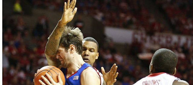 Kansas center Jeff Withey hits a wall as he tries to make a move against Oklahoma forward Romero Osby during the second half on Saturday, Feb. 9, 2013 at Noble Center in Norman, Oklahoma.