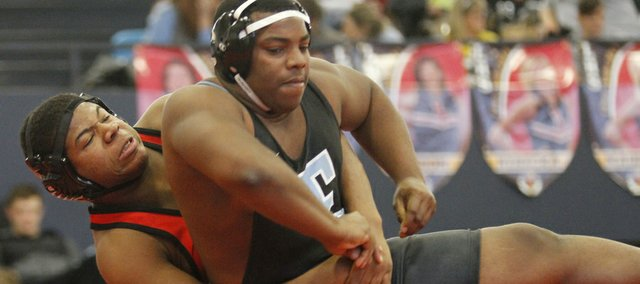 Lawrence High wrestler Alex Jones, left, competes against Shawnee Mission Easts Dominique Atkinson at the Sunflower League wrestling tournament Saturday, Feb. 9, 2013 at Lawrence High School.