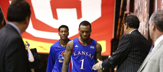 Kansas guard Naadir Tharpe hangs his head as he and Andrew White make their way to the lockerroom after the Jayhawks' 72-66 loss to Oklahoma on Saturday, Feb. 9, 2013 at Noble Center in Norman, Oklahoma. The loss is the Jayhawks' third-straight.