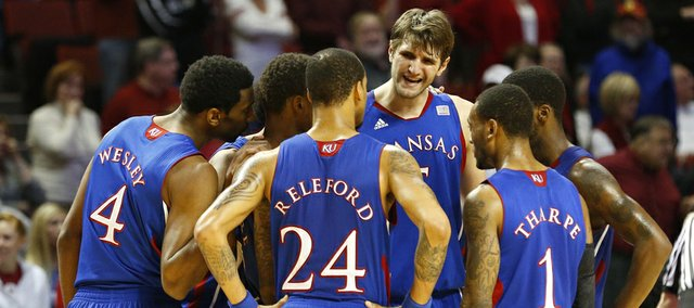 Kansas center Jeff Withey talks to his teammates with seconds left and the game out of reach on Saturday, Feb. 9, 2013 at Noble Center in Norman, Oklahoma.