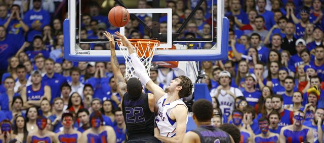 Kansas center Jeff Withey blocks a shot by Kansas State guard Rodney McGruder during the first half on Monday, Feb. 11, 2013. Earlier in the game, Withey set a new KU career block record.