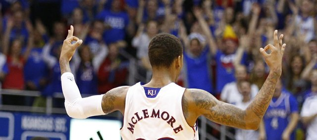 Kansas guard Ben McLemore signals three after hitting a shot over Kansas State during the second half on Monday, Feb. 11, 2013.