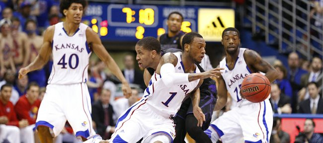 Kansas guard Naadir Tharpe steals the ball from Kansas State guard Rodney McGruder during the second half on Monday, Feb. 11, 2013.