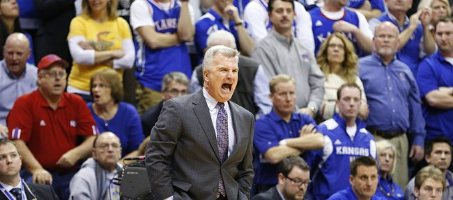 Kansas State head coach Bruce Weber yells at game officials after an intentional foul was called against KSU forward Jordan Henriquez during the first half on Monday, Feb. 11, 2013.