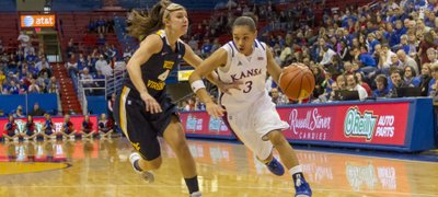 Kansas guard Angel Goodrich (3) drives past Brooke Hampton (4) during Kansas&#39; game against West Virginia, Saturday, Feb. 9, 2013 at Allen Fieldhouse.