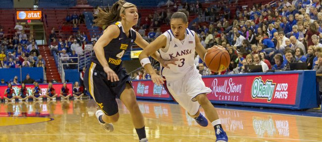 Kansas guard Angel Goodrich (3) drives past Brooke Hampton (4) during Kansas' game against West Virginia, Saturday, Feb. 9, 2013 at Allen Fieldhouse.