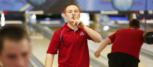 In a competitive but playful gesture, Lawrence High senior Austin Bennett shushes a section of cheering Olathe Northwest bowlers during Sunflower League bowling on Thursday, Feb. 14, 2013 at Royal Crest Lanes.