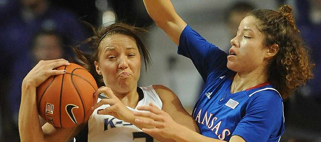 KU guard Monica Engelman, right, puts pressure on Kansas State's Brittany Chambers on Saturday, Feb. 2, 2013, in Manhattan.