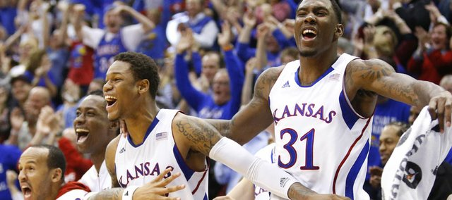 Kansas players Ben McLemore and Jamari Traylor (31) and other players go wild after a bucket by Tyler Self in the final minutes against Texas on Saturday, Feb. 16, 2013 at Allen Fieldhouse.