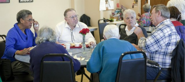 Seniors at the Douglas County Senior Services, 745 Vermont St., visit during the noon meal at the center, Friday, Feb. 15, 2013. Seniors are encouraged to take advantage of lunch at the center to get a nutritionally balanced meal. Senior Services also delivers meals.