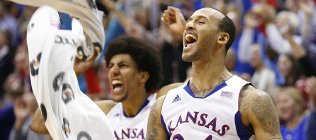 Kansas players Travis Releford (24) and Kevin Young go wild after a 360 jam by teammate Ben McLemore against Texas during the second half on Saturday, Feb. 16, 2013 at Allen Fieldhouse.