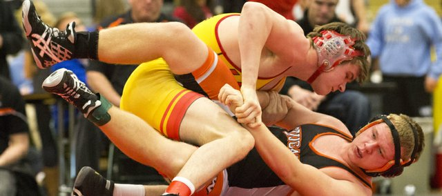 Lawrence High wrestler Andrew Denning, top, pins Shawnee Mission Northwest's Zack Newcomb in the 182 pound state regional championship wrestling match, Saturday, Feb. 16, 2013 at Free State.