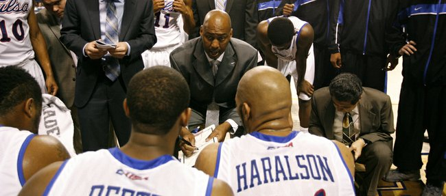 Former Kansas University All-American Danny Manning talks to his Tulsa team during a timeout in a game played during in his first year as head coach of the Golden Hurricane in 2013.