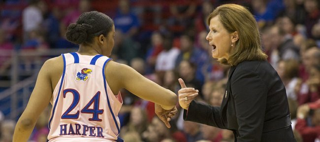 "Kansas women's coach Bonnie Henrickson discusses things over with CeCe Harper during Kansas' annual ""Jayhawks for a Cure"" cancer awareness game against Oklahoma, Sunday, Feb. 17, 2013 at Allen Fieldhouse."