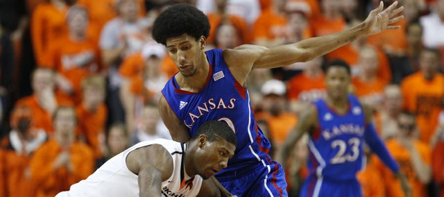 Kansas forward Kevin Young defends against a drive from Oklahoma State guard Marcus Smart during the first half on Wednesday, Feb. 20, 2013 at Gallagher-Iba Arena in Stillwater, Oklahoma.