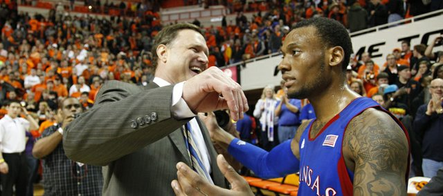 Kansas guard Naadir Tharpe gets a hug from head coach Bill Self after sinking a floater to give the Jayhawks the advantage over Oklahoma State with seconds remaining in double overtime on Wednesday, Feb. 20, 2013 at Gallagher-Iba Arena in Stillwater, Oklahoma.