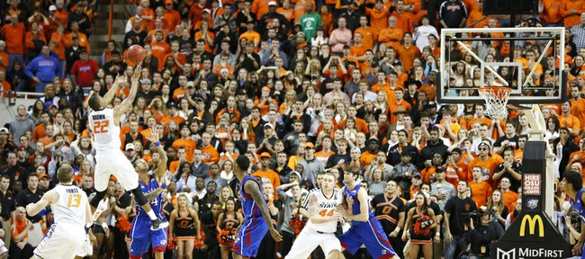 Oklahoma State guard Markel Brown goes up for a shot with seconds remaining in double overtime on Wednesday, Feb. 20, 2013 at Gallagher-Iba Arena in Stillwater, Oklahoma. The shot missed and the rebound went to the Jayhawks.