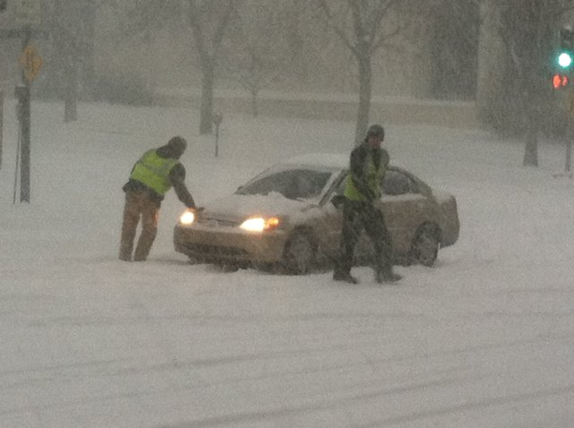 City crews stopped to help a motorist at the intersection of Vermont and Seventh streets about 8 a.m. Thursday.