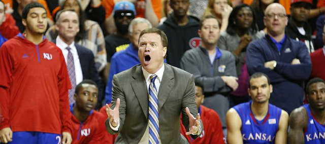 Kansas head coach Bill Self looks for a foul that wasn't called against Oklahoma State on a last second drive by KU guard Travis Releford which sent the game into double overtime on Wednesday, Feb. 20, 2013 at Gallagher-Iba Arena in Stillwater, Oklahoma.