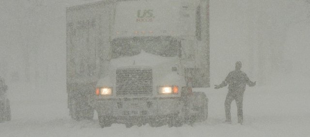 A semi truck is stuck at 7th and Vermont St. during Thursdays snow storm.