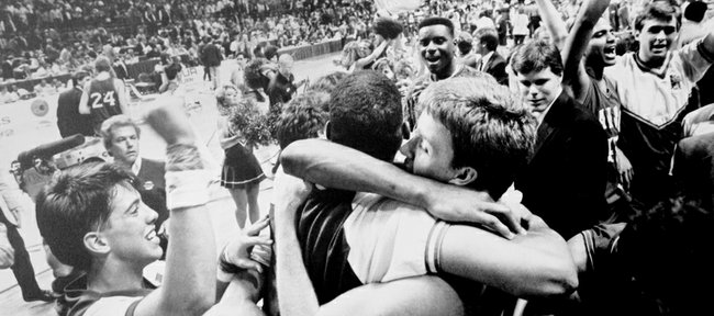 Kansas' Jeff Gueldner, right, is at the center of this hug scrum as time ran out on the 1988 national title game.