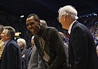 Kansas great Jo Jo White laughs with former Jayhawks coach Ted Owens during a halftime ceremony recognizing 115 years of basketball at KU, Saturday, Feb. 23, 2013 at Allen Fieldhouse.