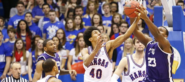 Kansas forward Kevin Young looks to pull a rebound from Texas Christian forward Devonta Abron during the second half on Saturday, Feb. 23, 2013 at Allen Fieldhouse.