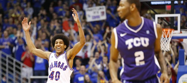 Kansas forward Kevin Young raises his arms in celebration after a dunk against Texas Christian during the first half on Saturday, Feb. 23, 2013 at Allen Fieldhouse.