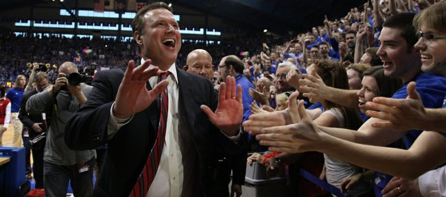 Kansas head coach Bill Self slaps hands with the fans following the Jayhawks' 87-86 overtime win over Missouri on Saturday, Feb. 25, 2012 at Allen Fieldhouse.